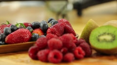 Beautiful strawberries blueberries raspberries and kiwi Stock Footage