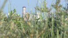 VLISSINGEN, THE NETHERLANDS: city skyline behind dune vegetation. Stock Footage