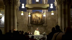 Church Service at the Crypt of the basilica of La Sagrada Familia. Stock Footage