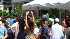 Timelapse Sequence Crowd walking through London's Columbia Road Flower Market. - stock footage