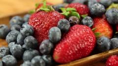 Juicy strawberries blueberries raspberries and kiwi Stock Footage