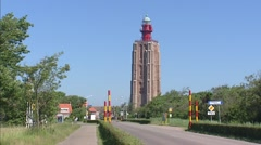 Tall lighthouse of Westkapelle, The Netherlands, at the entrance to the village Stock Footage