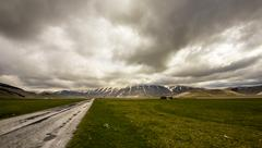 bad weather on the road to castelluccio, italy - stock photo