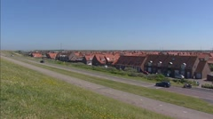 Westkapelle village behind sea dike + pan dike - North Sea. Stock Footage