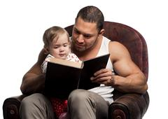 Stock Photo of father reading book to daughter, isolated on white background