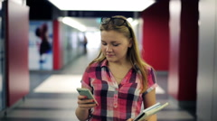 Young teenager walking with smartphone in the tunel HD Stock Footage