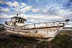 Old boat on abandoned junk yard. Stock Photos