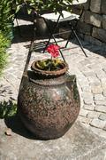 Old pottery in garden closeup - stock photo