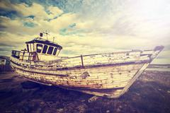 Vintage old boat on junk yard. Stock Photos
