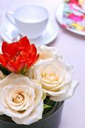 Coffee set with flower arrangement Stock Photos