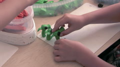 Boy sculpts from plasticine Stock Footage