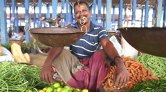 Local man selling his produce at Hikkaduwa Sunday market. Stock Footage