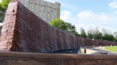 Curved wall and stairs with crashing waterfall Stock Footage