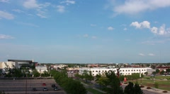 Clouds roll away and sun shines on downtown Wichita Stock Footage