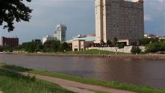 Pan across Arkansas River in downtown Wichita, KS Stock Footage