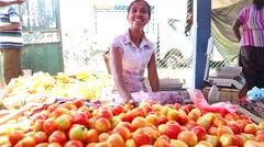 Local woman selling tomatoes at Hikkaduwa Sunday market. Stock Footage