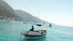 Small motor boat moored in scenic Turkish cove Stock Footage