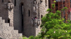 Tourists on the balcony of the  Passion tower of Sagrada Familia church Stock Footage