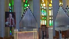 Inside of the Sagrada Familia church. Interiors & Organ pipes. - stock footage