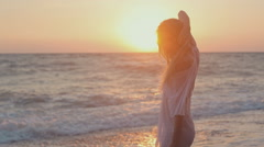 Stock Video Footage of Seductive girl withe long hair posing at sunset on the beach