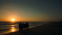 College Students on the Beach at Sunset Stock Footage
