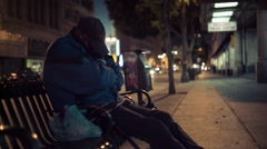 Homeless Man Sleeping on Bench - stock footage