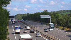 Busy motorway traffic flowing smoothly Stock Footage