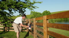 Fence staining Stock Footage