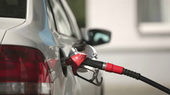 The driver pumping gasoline at the gas station. Closeup - stock footage