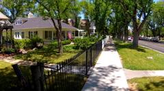 Sidewalk And Homes In Beautiful Tree Lined Neighborhood Stock Footage