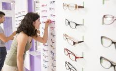 choosing glasses - stock photo