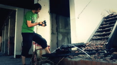 Photographer with camera  in Ruined house making shots,effects 2 Stock Footage