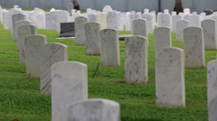 Pan of Headstones in a Military Cemetery Stock Footage
