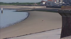 Vlissingen seaside boulevard and beach with lonesome sunbather Stock Footage