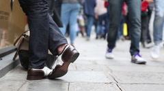 Elegant man waits on busy street Stock Footage