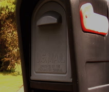 Placing mail in mailbox Stock Footage