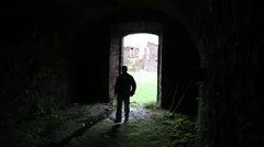 A man wanders into a dark room or place Stock Footage