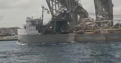 Freighter under 2 bridges - stock footage