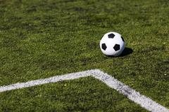 green pitch with soccer ball - stock photo