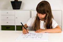 girl writing the abc alphabet - stock photo