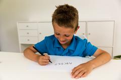 Boy writing the abc alphabet Stock Photos