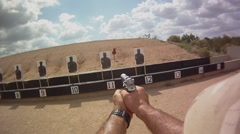 Pistol Targets Rotate as Shooter Presents His Weapon Stock Footage