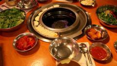 Korean banchan preparation before BBQ Stock Footage