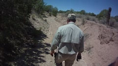 Man Walks Down Dry Ravine Stock Footage