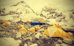 tents in everest base camp in cloudy day, nepal, vintage style - stock photo