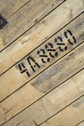 Numbers and letters written with paint on wood. Kuvituskuvat