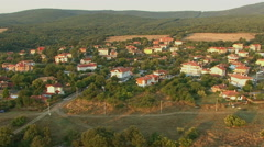 Flight over urban village in mountain. Aerial View.  Stock Footage