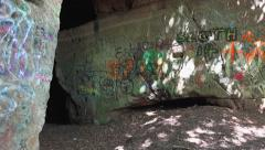 Cave entrance covered in graffiti to ancient man-made quarry - Abandoned Spaces Stock Footage