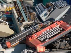 Junk typewriters outside in the yard Stock Photos