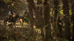 Soldier's moving through woods Stock Footage
